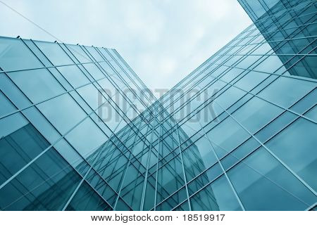 blue transparent textured wall of glass skyscraper in business center