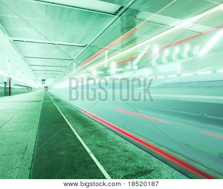 vanishing trail of green train with red lights in motion