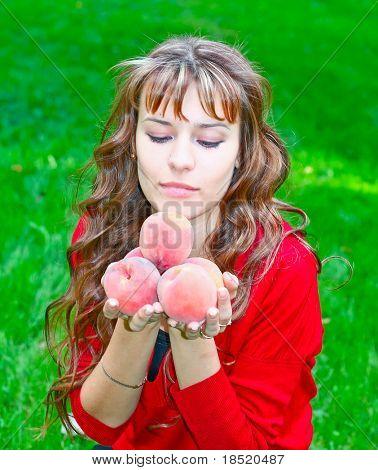 cute girl with peaches
