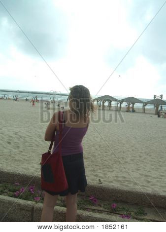 Young Woman Standing Alone Beside The Beach