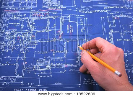 Hand and blueprint
