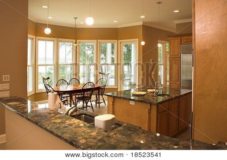 Expensive kitchen looking out into dining area