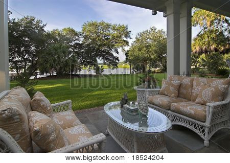 covered patio looking out onto waterfront property