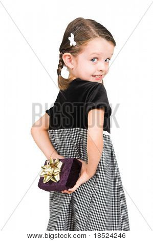 little girl hiding gift behind her back, isolated over white