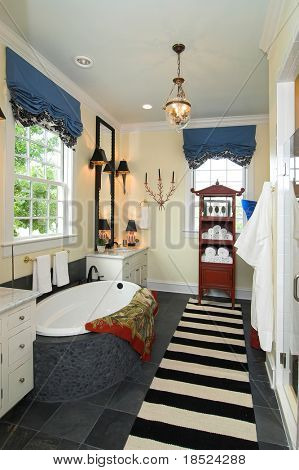 modern bathroom with cabinets and whirlpool tub