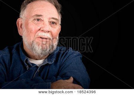 grieved old man weeping, over black