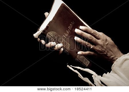 elderly african american hands holding bible