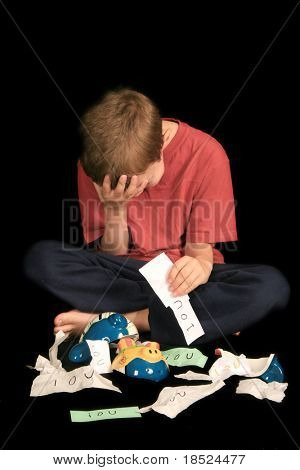 little boy in despair over finding his bank full of iou's