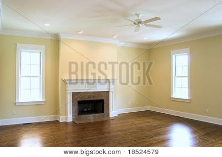 empty living room with granite fireplace and windows