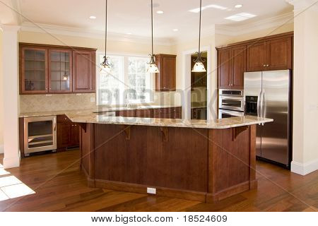 opulent kitchen with dark wood and stainless appliances