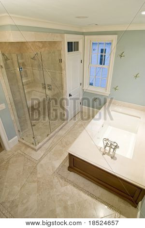 luxury bathroom with whirlpool tub and glass shower