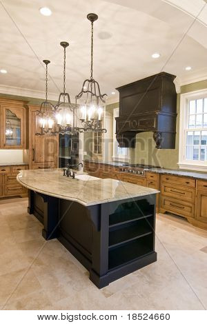 opulent kitchen with complimentary colored cabinets and granite island