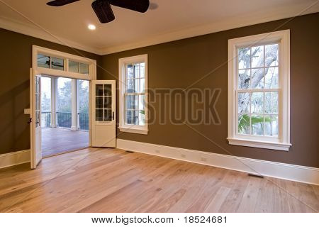 large unfurnished bedroom or diningroom with open doors to porch