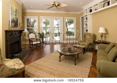comfortable livingroom with view of water. Painting has been cloned to be unrecognizable
