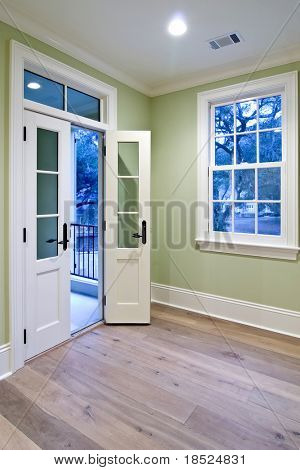 bedroom with double doors open to porch