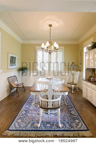 tasteful diningroom with windows and wainscot