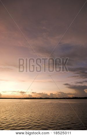 dramatic cloudscape over water with reflections