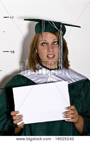 senior graduation picture, purposefully done poorly, student holding blank sign and standing in front of height chard