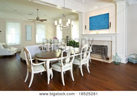 elegant diningroom and livingroom with fireplace