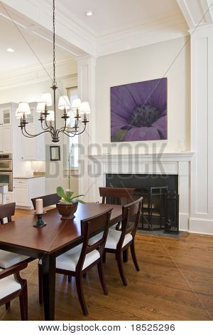 beautiful diningroom with fireplace looking out to kitchen