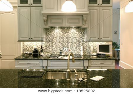 beautiful kitchen with glass backsplash and granite counter