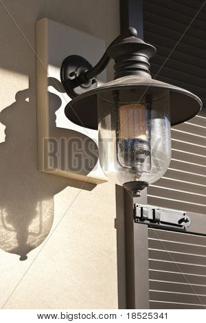 front entrance lamp and hurricane shutter