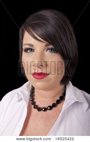 dark haired woman with heavy makeup, wide angle shot