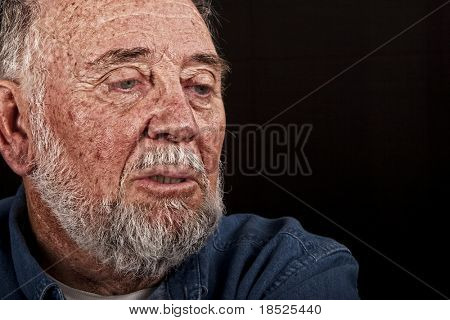 very old man weeping, over black background