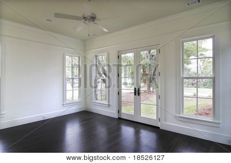 empty dining or bedroom with door to yard.
