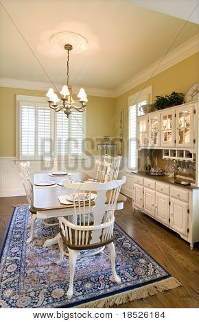classically decorated diningroom with china cabinet