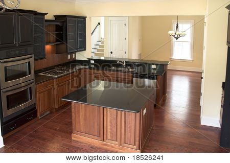beautiful kitchen with black granite and warm woods