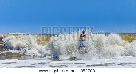 surfer getting hit by large wave on the atlantic