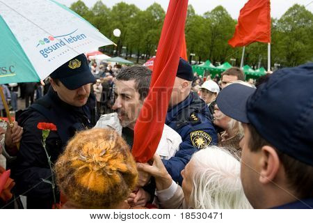 RIGA, LATVIA, MAY 9, 2009: Vladimir Linderman, member of the banned National Bolshevik party (NBP) is arrested for using forbidden Soviet Union flag