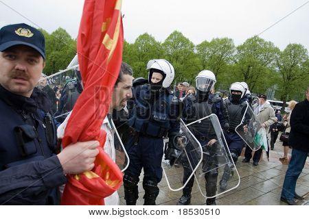 RIGA, LATVIA, MAY 9, 2009: Vladimir Linderman, member of the banned National Bolshevik party (NBP) is arrested for using forbidden Soviet Union flag.