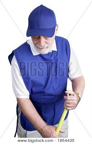 Senior Worker - Sweeping Up