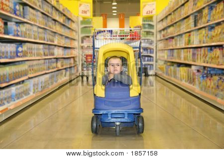 Boy In The Toy Automobile