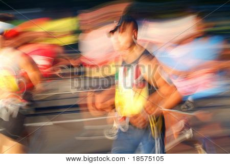 Marathon runners head into the sun during the early stages of a race.