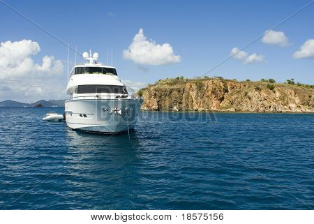 A luxury yacht anchored in the Caribbean.