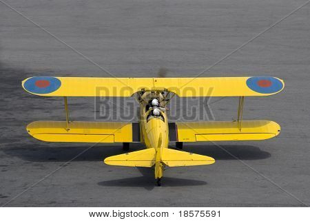 A vintage (circa 1942) Boeing Stearman PT-27 Kaydet trainer prepares for takeoff.