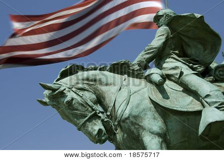 A detail of the Ulysses S. Grant Memorial with Old Glory flying in the background. (The Grant Memorial includes the largest equestrian statue in the United States.)