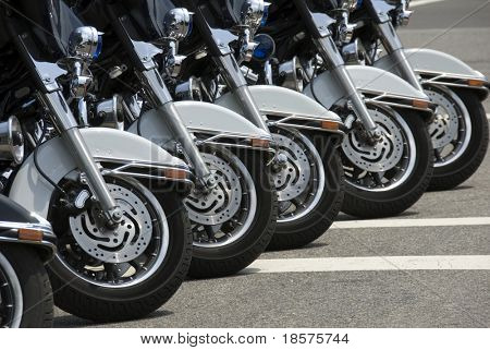 Six police motorcycles parked on the National Mall in Washington, DC.