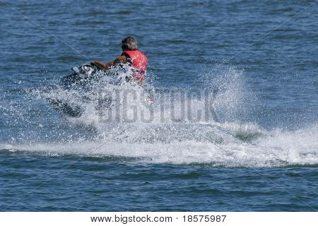 A man riding a late model jet boat.