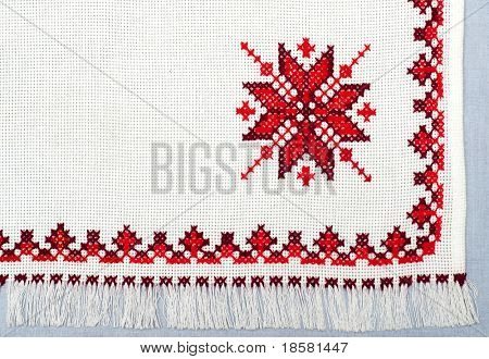 part of embroidered serviette by cross-stitch pattern