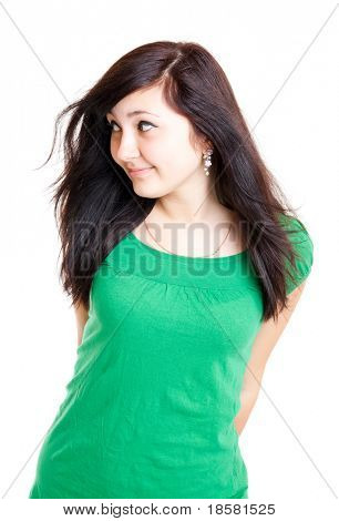 cheerful charming brunette female in green dress isolated on white