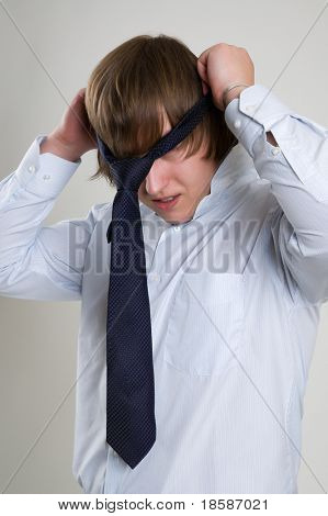 businessman with tie on head