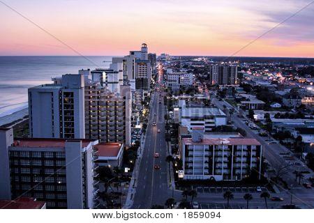 Cidade da praia por do sol