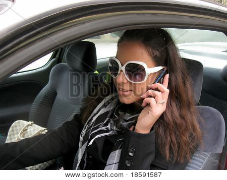 Girl talking on the mobile in the car