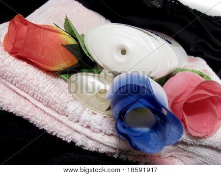 Shampoo bottle and roses