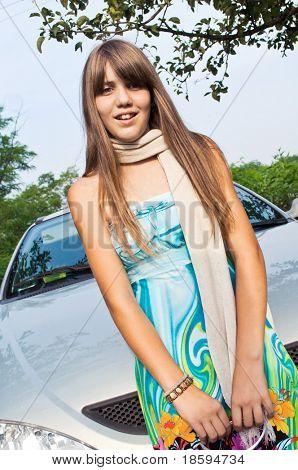 Girl posing next to the car