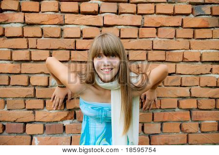 Young girl posing in front of the wall